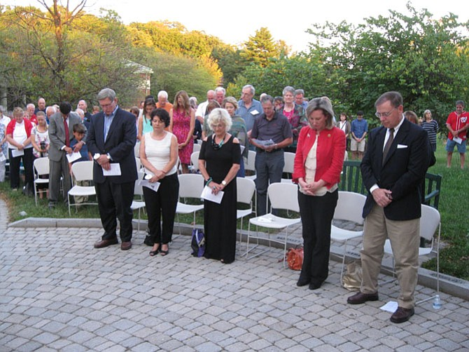 Fairfax County Supervisor John Foust, Virginia State Senator Barbara Favola, Friend of the Freedom Memorial Sara Hilgartner, U.S. Representative Barbara Comstock, and Drug Enforcement Administration Acting Director Chuck Rosenberg observe a moment of silence at the Freedom Memorial in Great Falls, Virginia on September 11, 2016