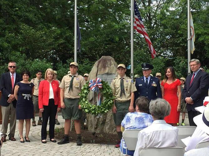 Local dignitaries, assisted by the Boy Scouts, lay a wreath at the Freedom Memorial in Great Falls, Virginia on Memorial Day, May 30, 2016. Photo taken from and links to a story in the Great Falls Connection.
