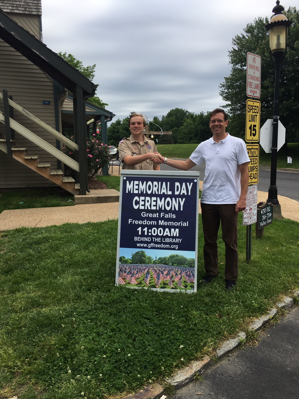 Boy Scout Alex Bonadio with finished sign and Freedom Memorial director Bruce Fein